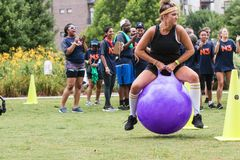Woman Gets Airborne On Bouncy Ball At Atlanta Field Day royalty free stock photography