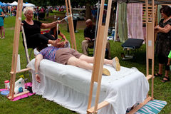 Woman Gets Ashiatsu Barefoot Massage At Summer Festival Stock Image