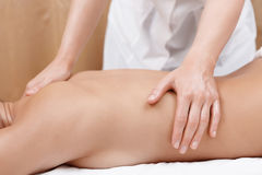 Woman gets back massage Stock Photography