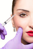 Woman gets cosmetic injection. Beauty Treatment Stock Photos