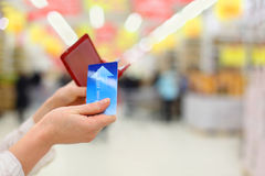 Woman Gets Credit Card From Purse In Store Royalty Free Stock Images