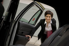 Free Woman Gets In To Cab Back Seat Downtown Royalty Free Stock Photos - 26504008