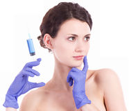 Woman gets an injection in her face Royalty Free Stock Images
