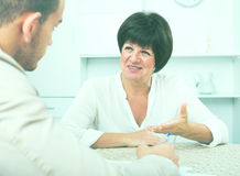Woman gets job and discusses with employer Royalty Free Stock Image