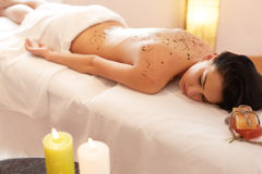 Woman Gets a Marine Algae Wrap Treatment in Spa Salon Royalty Free Stock Photo