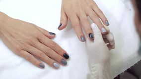 Woman gets a new paint gray fingers stock footage