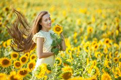 Woman gets a relaxation in the field. Stock Photo