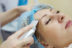 Woman gets a skin treatment. In beauty salon Royalty Free Stock Photography