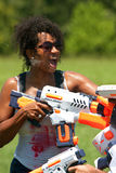 Woman Gets Squirted In Face With Water Gun Royalty Free Stock Photo