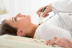 Woman Gets Ultrasound Of The Thyroid From Doctor Royalty Free Stock Photos