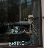 Woman gets wifi and brunch at downtown Chicago coffee shop. Stock Photos