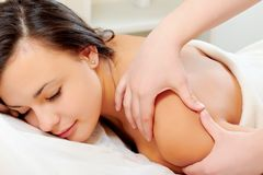 Woman Getting A Back Massage Stock Image