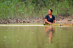 Woman getting across the river in Thailand Royalty Free Stock Photo