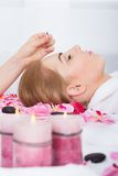 Woman Getting Acupuncture Treatment. Close-up Of A Young Woman Getting Acupuncture Treatment Royalty Free Stock Images