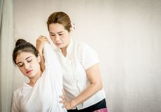 Woman getting arm massage stretch in Thai massage Royalty Free Stock Photography