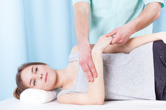 Woman getting arm massage Stock Image