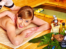 Woman getting aroma massage. Stock Photo