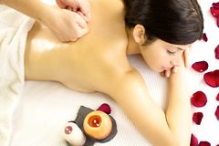 Woman getting back massage from male professional therapist Stock Images