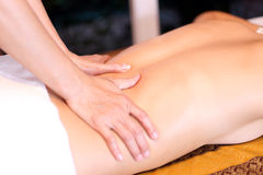 Woman getting back massage Royalty Free Stock Photography