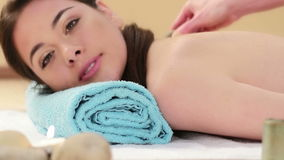 Woman getting back massage stock video footage