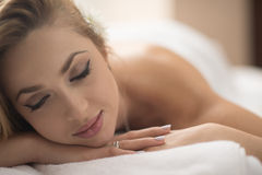 Woman getting back massage in spa salon Stock Images