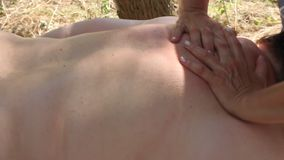 Woman getting back massage. stock video footage