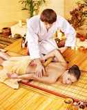 Woman getting bamboo massage. Royalty Free Stock Photos