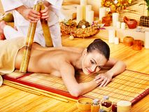 Woman getting bamboo massage. Royalty Free Stock Image