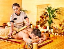 Woman getting bamboo massage. Stock Photo