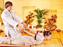 Woman getting bamboo massage. Royalty Free Stock Photography