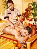 Woman getting bamboo massage. Stock Images