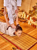Woman getting bamboo massage Stock Images