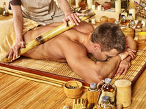 Woman getting bamboo massage Stock Photography