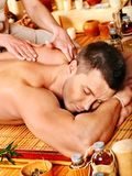 Woman getting bamboo massage. Stock Photography
