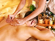 Woman getting bamboo massage. Royalty Free Stock Photo