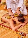 Woman getting bamboo massage Stock Photos