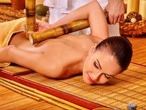 Woman getting bamboo massage Royalty Free Stock Image