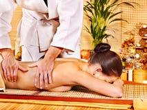 Woman getting bamboo massage. Stock Photos