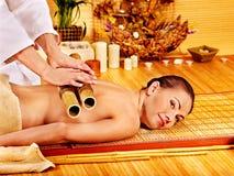 Woman getting bamboo massage. Stock Photography