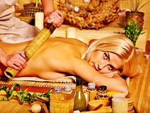 Woman getting bamboo massage. Stock Image