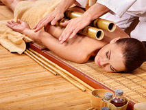 Woman getting bamboo massage Stock Photo