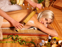 Woman getting bamboo massage Royalty Free Stock Image