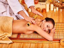 Woman getting bamboo massage Stock Photos