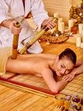Woman getting bamboo massage Stock Image