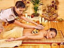 Woman getting bamboo massage. Stock Image