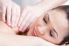 Woman getting body massage Stock Image