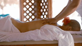 Woman getting body massage at beauty spa stock video footage