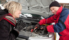 Woman getting a boost for her car Stock Photo