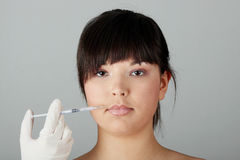 Woman getting botox injection Stock Photography