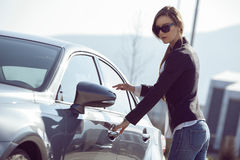 Woman getting in a car Stock Photography